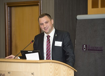 Charity fundraiser Gary speaking at a conference